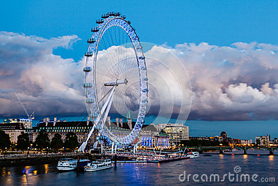London Eye and Huge Cloud on London Cityscape Editorial Photography