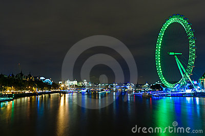 The London Eye illuminated at night Editorial Stock Image