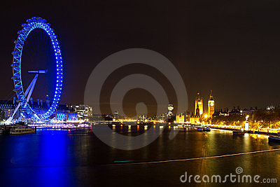 London Eye and Parliament Building Editorial Stock Image