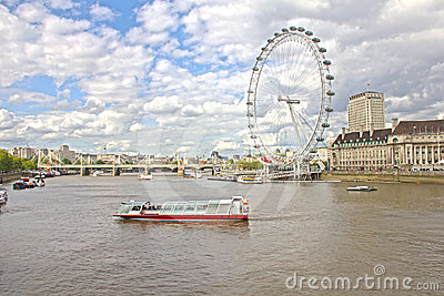 The London Eye and the Thames river Editorial Photography