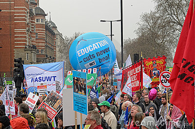 LONDON - MARCH 26: Protesters march against public expenditure cuts in a rally -- March for the Alternative -- organised by the Tr Editorial Image