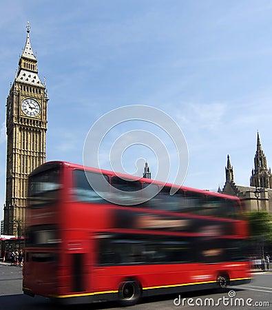 London red bus passing Big Ben