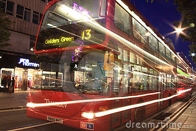 London  red double decker bus at night Editorial Photo