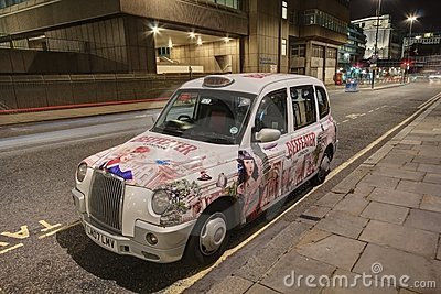 London Taxi Cab with advertising paintwork Editorial Image