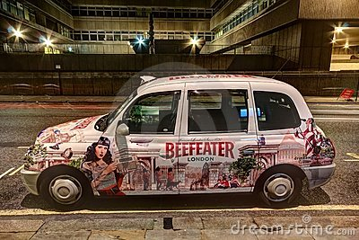 London Taxi Cab with advertising paintwork Editorial Photo