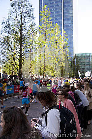 LONDON, UK - APRIL 13, 2014 - London Marathon in Canary Wharf aria, massive sport event for professionals and amateurs sportsmen,