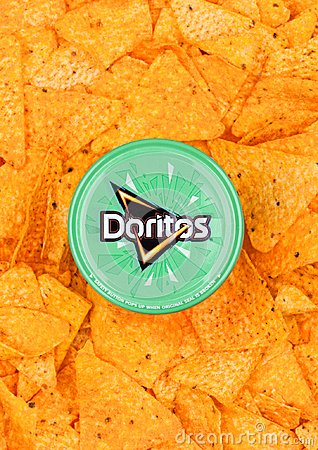 Free LONDON, UK - DECEMBER 01, 2017: Doritos Tortilla Chips Container With Cool Sour Cream And Chives Dip With Nachos Royalty Free Stock Photos - 105131858