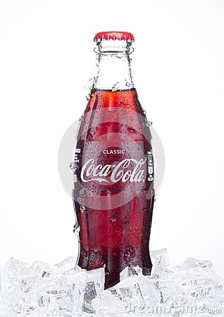 Free LONDON, UK - JANUARY 20, 2018: Cold Glass Bottle Of Coca Cola Drink  With Ice And Dew On White. The Drink Is Produced And Manufact Royalty Free Stock Photography - 108098777