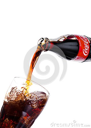 Free LONDON, UK - JANUARY 20, 2018: Pouring Coca Cola Soda Drink From Bottle To Glass On White. The Drink Is Produced And Manufactured Stock Photography - 108099032