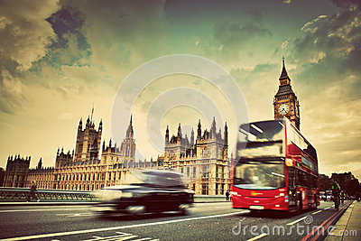 London, the UK. Red bus, taxi cab in motion and Bi