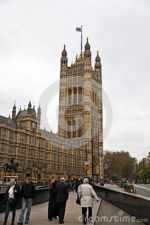 LONDON, WESTMINSTER, UK - APRIL 05, 2014 Houses of Parliament and Parliament tower, view from the Abingon St Editorial Stock Image