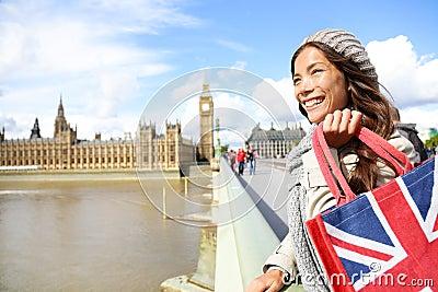 London woman holding shopping bag near Big Ben