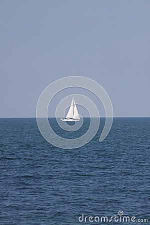 Free Lone Sailboat At Sea Stock Photo - 12498250
