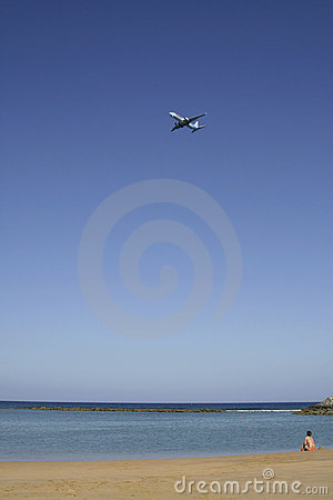 Lone sunbather watches her plane leave