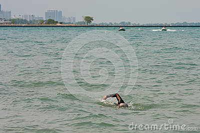 Lone Swimmer Swims Lake Michigan Editorial Photo