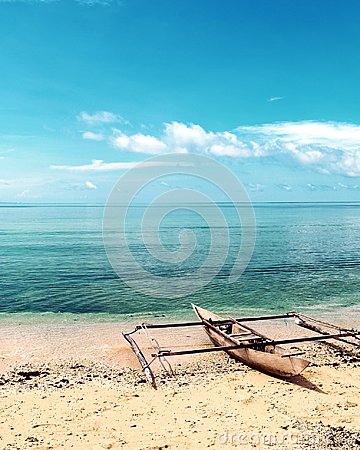 Lonely Boat on an Isolated Beach in Raja Ampat, West Papua, Indonesia Stock Photo