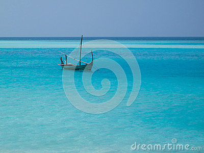 Lonely boat on blue sea