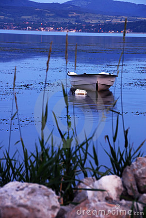 Free Lonely Boat On Blue River Royalty Free Stock Images - 20371909