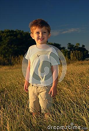 Lonely boy in the field