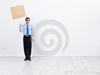 Lonely businessman with empty placard