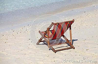 Сhaise lounge on a beach