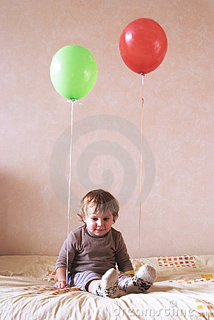 Lonely child with balloons