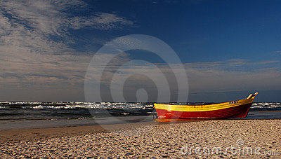 Lonely fishing boat on Baltic sea seaside