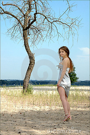 Free Lonely Girl In A Beautiful Silver Dress On The Be Royalty Free Stock Photo - 14584915