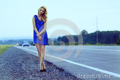 Lonely girl on the roadside