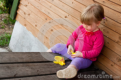 Lonely girl with toy