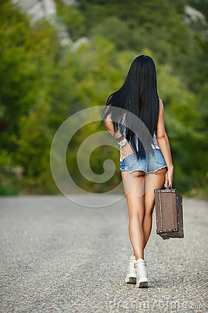 Free Lonely Girl With A Suitcase On A Country Road ... Stock Photography - 43859072