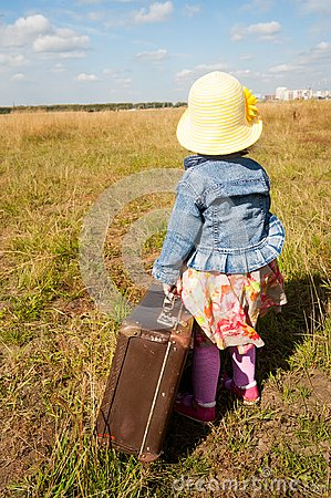 Free Lonely Girl With Suitcase. Back View Royalty Free Stock Image - 30217916