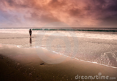 Lonely man walking at beach