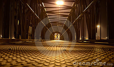 Lonely pedestrian bridge at night