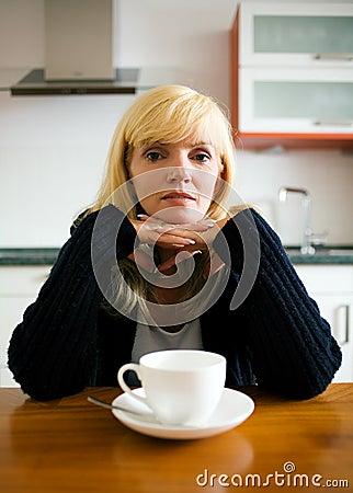 Lonely woman having breakfast