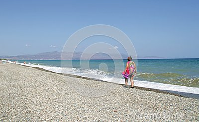 Lonely woman on a shore