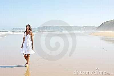 Lonely young woman at the beach