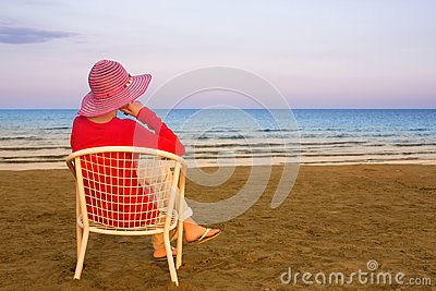 Lonely young woman near the ocean