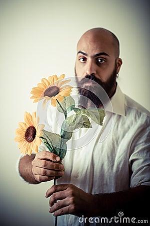 Long beard and mustache man giving flowers