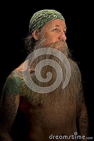 Long bearded man issolated on black