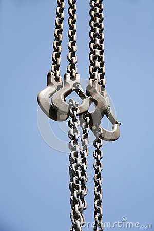 Free Long Chains With Hooks Hanging Vertically Against Blue Sky Royalty Free Stock Photography - 80000127