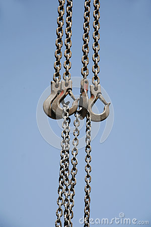 Free Long Chains With Hooks Hanging Vertically Against Blue Sky Royalty Free Stock Image - 80000166