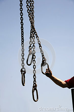 Free Long Chains With Hooks Hanging Vertically Against Blue Sky Stock Photography - 80000242