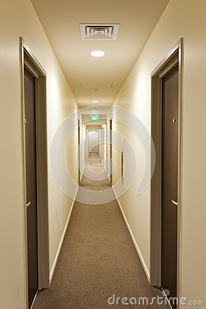 Long Corridor With Hotel Room Doors And Exit Sign Royalty Free Stock Photo Image 25759785