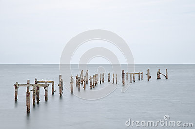 Long exposure derelict pier in calm sea