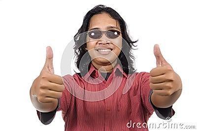 Long hair man with sunglasses give thumb