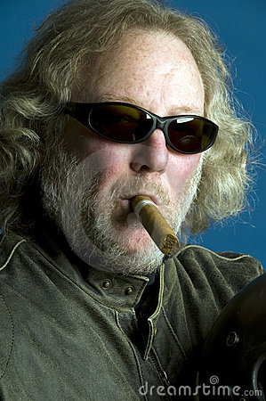 Long hair senior smoking cigar