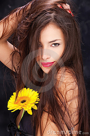 Long hair and yellow daisy