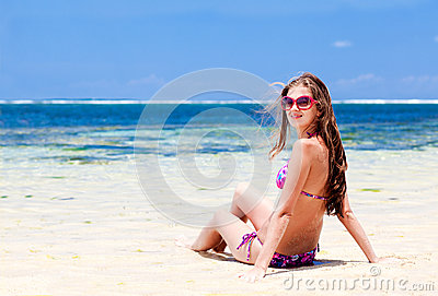 Long haired girl in bikini on tropical bali beach