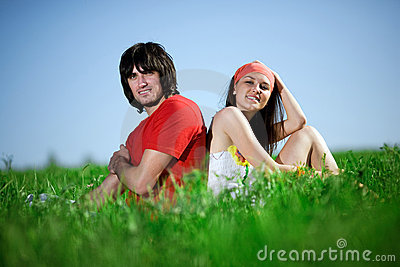 Long-haired girl with boy on grass